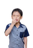 Boy wipes his nose by tissue paper Stock Photos