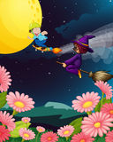 A boy and witch flying Stock Images