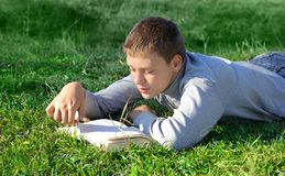 Boy With A Book Royalty Free Stock Photography