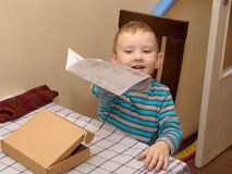 Boy With A Cardboard Box Stock Photos