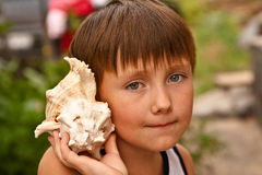 Free Boy With A Shell Stock Photography - 17400522