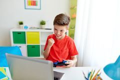 Free Boy With Gamepad Playing Video Game On Laptop Stock Image - 104329621