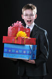 Boy With Gifts Royalty Free Stock Photos