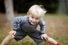 Boy With Hands On Knee Royalty Free Stock Images