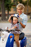 Boy With His Mother Sitting On The Scooter Royalty Free Stock Photo