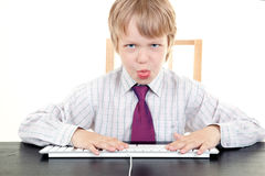 Boy With Keyboard Royalty Free Stock Image