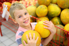 Boy With Melons In Shop Royalty Free Stock Images