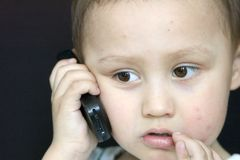 Boy With Mobile Phone Royalty Free Stock Images