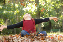 Boy With Outstretched Arms Stock Image