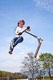 Boy With Scooter Is Going Airborne Royalty Free Stock Images