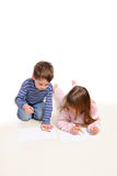 Boy With The Girl Draw On A White Stock Image