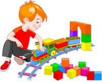 Boy With Train Set Royalty Free Stock Photo