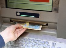 Free Boy Withdraws Money From An ATM With Euro Currency Royalty Free Stock Images - 114025699