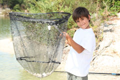 Boy withfishing net Stock Photo