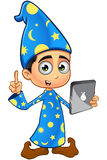 Boy Wizard In Blue - Holding A Tablet. A cartoon illustration of a Boy Wizard dressed in a blue robe Royalty Free Stock Images