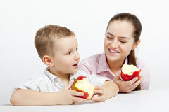 Boy, woman and afternoon snack Stock Photo