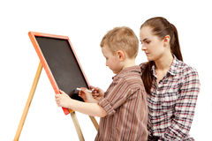 A boy, woman and blackboard.Writing Stock Photos