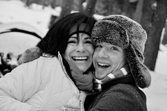 Boy and Woman Playing in the snow. A teenage boy and middle-aged women hugging and laughing while playing in the snow Royalty Free Stock Photos