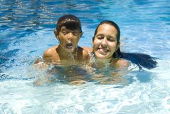 Boy and Woman in Pool. Woman with a child in the pool Royalty Free Stock Photo