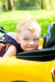 Boy won his yellow car Royalty Free Stock Image