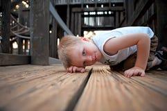 Boy wonder 4. Boy playing hide and seek in park Royalty Free Stock Photo