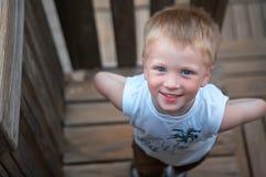 Boy wonder. Boy playing hide and seek in park Royalty Free Stock Image