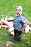 Boy with wood chopper Royalty Free Stock Photos