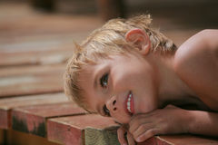 Boy on wood planks Stock Photos