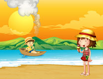 A boy in a wooden boat and a girl at the seashore Royalty Free Stock Images