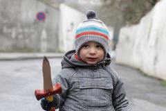 Boy with a wooden dagger Stock Photo