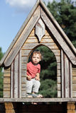 Boy at wooden house Stock Images