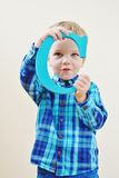 Boy with a wooden letter Royalty Free Stock Image