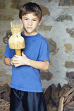 Boy with Wooden Mallet Royalty Free Stock Image