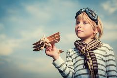 Boy with wooden plane Royalty Free Stock Image