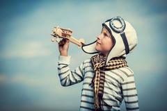 Boy with wooden plane Stock Photography