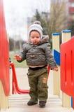 Boy on wooden platform Stock Photo