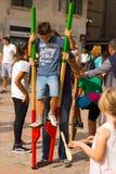 Boy on Wooden Stilts Stock Photos