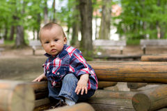 Boy on a wooden train in a park Stock Images