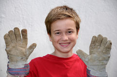 Boy with work gloves Stock Photography