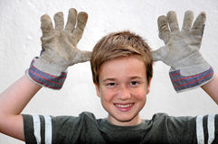 Boy with work gloves Royalty Free Stock Photo