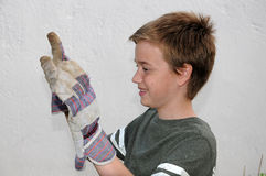 Boy with work gloves Stock Image