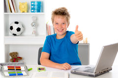 Boy is working with book and computer Royalty Free Stock Photo