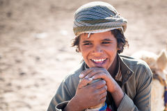 Boy working with camels in Bedouin village on the desert Royalty Free Stock Images