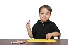Boy working at a desk Royalty Free Stock Image
