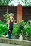 Boy working in the garden Stock Photos