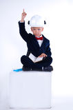 A boy in a working helmet. The boy working in a helment with a raised finger up Royalty Free Stock Image