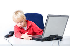 Boy working on a laptop Stock Photography