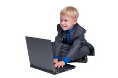 Boy working on a laptop Royalty Free Stock Photo