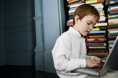 boy working on a laptop Royalty Free Stock Photos