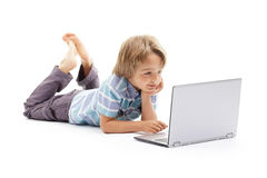 Boy working on laptop computer royalty free stock photography